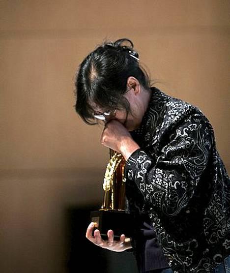38-vuotias Shi ei voinut vastaanottaa palkintoaan itse, sillä hän kärsii kymmenen vuoden vankilatuomiota Kiinassa.