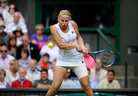 Wimbledonin valkoisissa 2011. Dokicin oli lopetettava uransa muutama vuosi tämän jälkeen rannevamman takia.