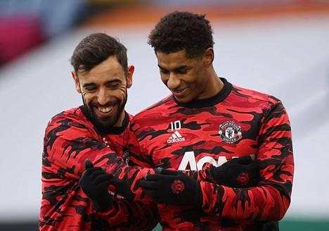 Bruno Fernandes (vas.) ja Marcus Rashford ovat Manchester Unitedin tehokaksikko.