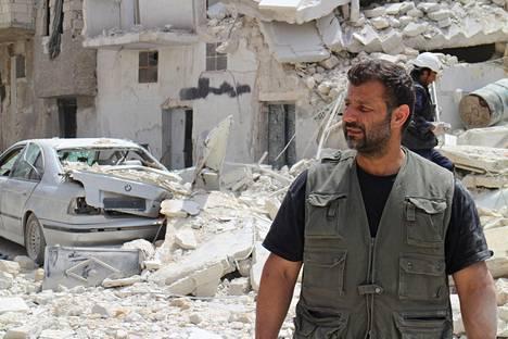 Rami Adham entisen kotikaupunkinsa Aleppon tuhojen keskellä eräällä vuoden 2014 matkallaan.