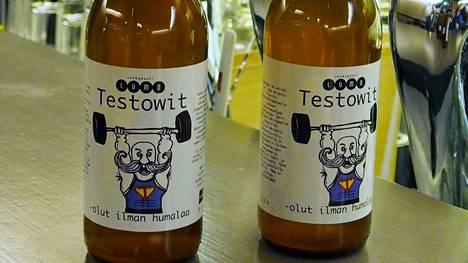 Testowitin etiketissä viiksekäs lihaskimppu nostaa rautaa ilmaan. Irtoaako oluesta tosiaan näin paljon testovoimaa?