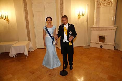 Rouva Haukion jäänsininen leninki vuonna 2014 painui monien mieleen.