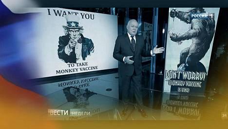 """Vesti-ohjelman juontaja Dmitri Kiseljov esitteli kuvia """"apinarokotteesta"""" Rossija 1 -televisiokanavalla lokakuussa. Kuvakaappaus lähetyksestä."""