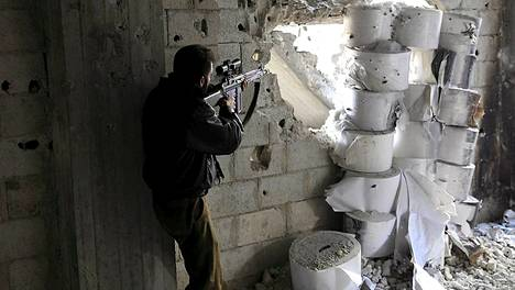 Syyrilaiskapinallinen Damaskoksessa lauantaina.