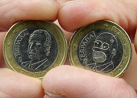 Vasemmalla Espanjan kunigas Juan Carlos, oikealla Homer Simpson.