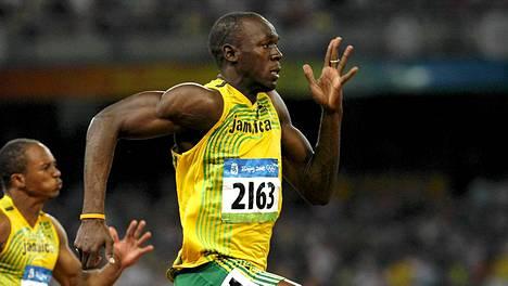 Usain Bolt vauhdissa Pekingin olympialaisissa 2008.