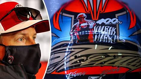 Kimi Räikkönen lähettää kypärässään onnitteluviestin Mark Arnallille.