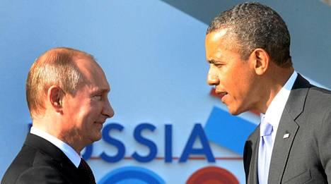 Venäjän presidentti Vladimir Putin ja Yhdysvaltain presidentti Barack Obama ovat sanasodassa. Kumpikin miehistä matkustaa Ranskaan perjantaina. Presidentit tapasivat Pietarissa viime syyskuussa.