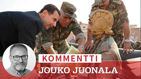 Bashar al-Assad vieraili Syyrian hallituksen joukkojen luona Idlibin maakunnassa 22. lokakuuta, kertovat uutistoimisto Sanan välittämän kuvan tiedot.