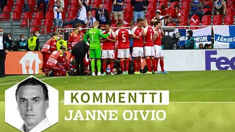 Tanskan pelaajat muodostivat muurin suojaamaan Erikseniä kameroilta.