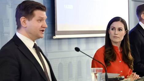 Valtiosihteeri Mikko Koskinen ja pääministeri Sanna Marin.