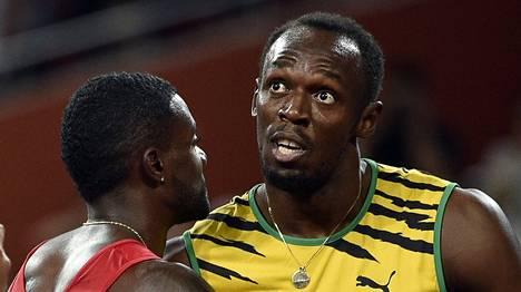 Justin Gatlin (vas.) ja Usain Bolt