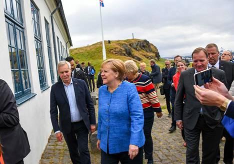 Antti Rinne, Angela Merkel ja Ruotsin pääministeri Stefan Löfven.