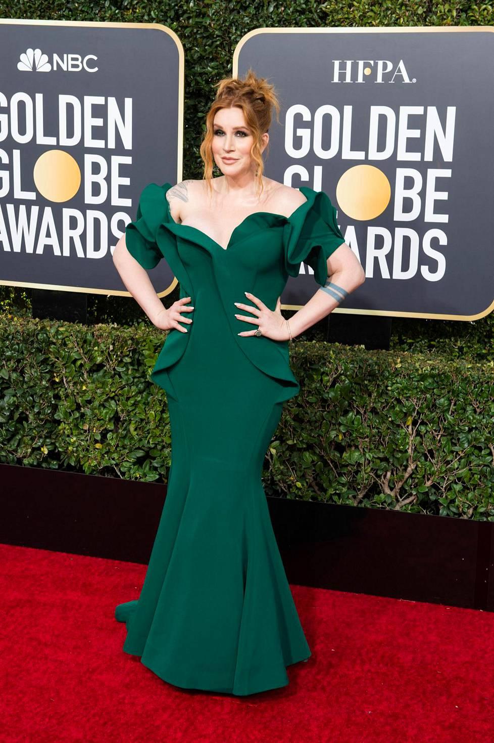 Pianisti Our Lady J luotti smaragdinvihreään.